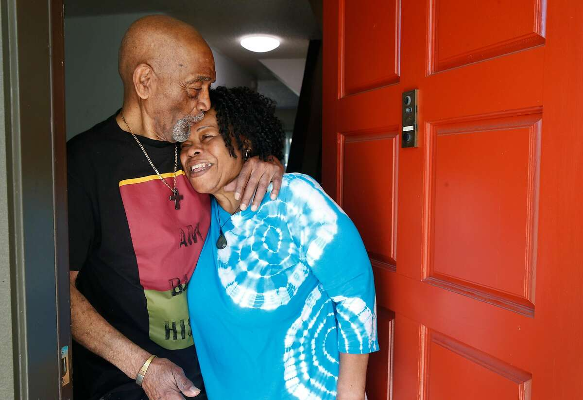 Ernest and Linda Hills stand in the doorway of their home in San Francisco, Calif. on Thursday, June 4, 2020. Ernest Hills uses the programs provided at the Bayview Hunters Point Adult Day Health Center but proposed cuts in the state budget could force the center to shut down.