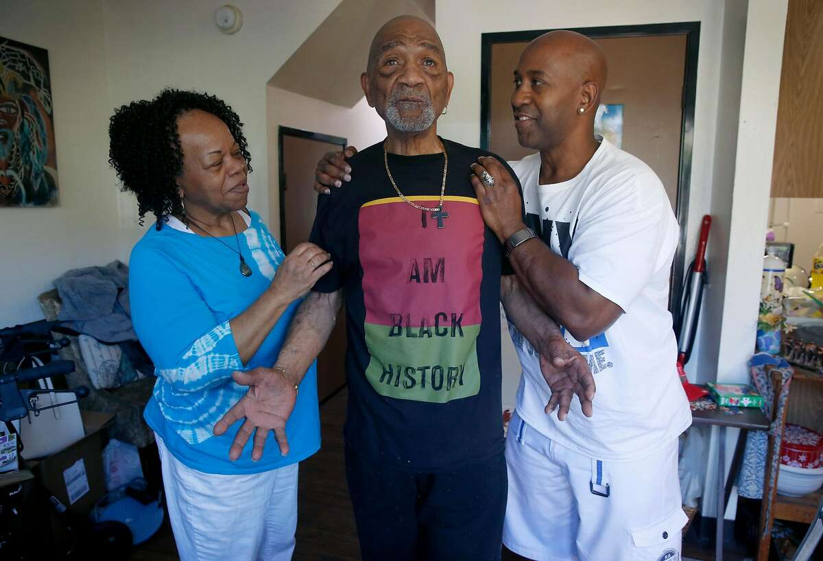 Ernest Hills, Sr. gets a lot of attention from his wife Linda and son Ernest, Jr. before his daily walk with Linda in San Francisco, Calif. on Thursday, June 4, 2020. Ernest Hills, Sr. uses the programs provided at the Bayview Hunters Point Adult Day Health Center but proposed cuts in the state budget could force the center to shut down.
