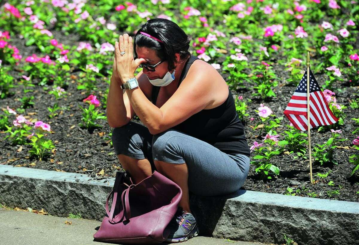 Ivette Diaz, a member of Kingdon Life Church, prays at a prayer vigil held by members of the Milford Clergy Association on Milford Green in Milford, Conn., on Thursday, June 4, 2020. Around 50 people gathered with the clergy to pray for our country in light of the deepening racial tensions in the aftermath of the death in police custody of George Floyd in Minneapolis.
