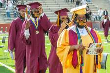 On Thursday morning, the first half of the senior class of Beaumont United process into Memorial Stadium for their graduation ceremony while wearing Class of 2020 masks. The Class of 2020 has dealt with floods, hurricanes, a pandemic, and the recent unrest as a result of the unnecessary deaths of black men across the country and they made it through. Photo made on June 4, 2020. Fran Ruchalski/The Enterprise