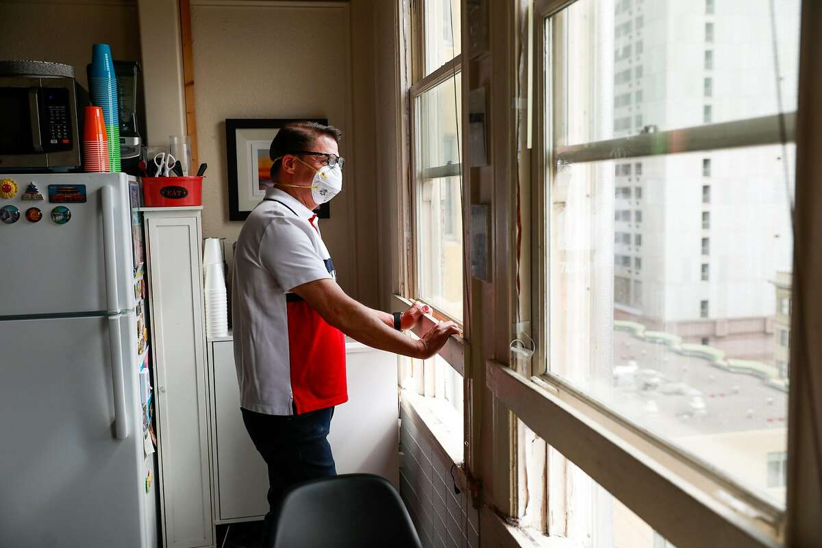 Activist Curtis Bradford, who has AIDS and has been told by his doctor not to leave his SRO, looks out the window on Sunday, May 31, 2020 in San Francisco, California.