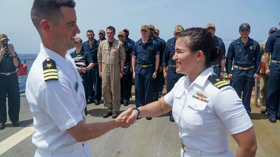 Lt. Shelby Ramirez, right, is congratulated by Cmdr. Ameian Jeremiah, executive officer of USS James E. Williams, for her promotion. Photo: Courtesy Of U.S. Navy, USS James E. Williams / MC3 Jairus P. Bailey / Digital
