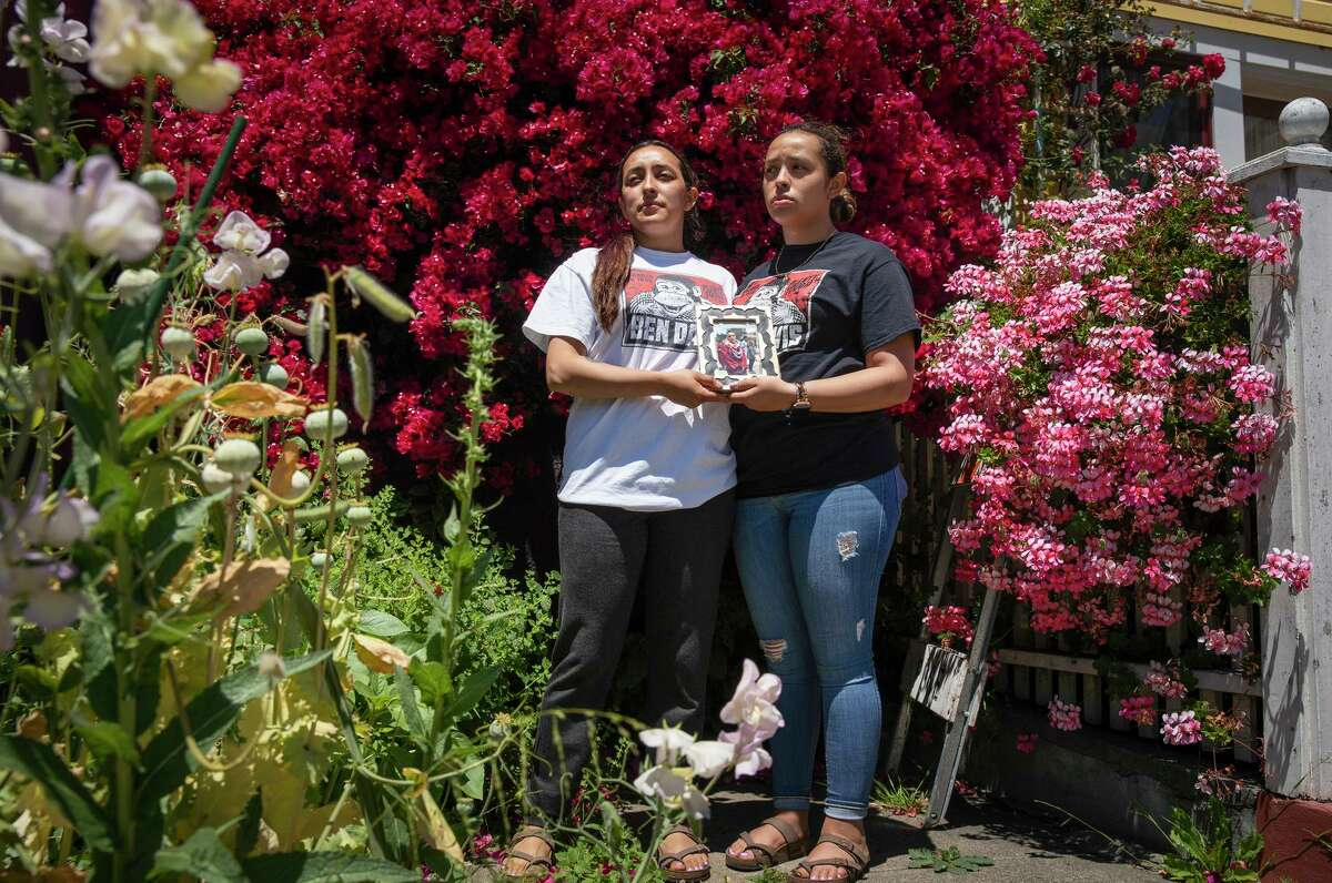 Sisters Michelle (left) and Ashley Monterrosa hold a portrait of their brother, Sean, 22, who was fatally shot by Vallejo police.