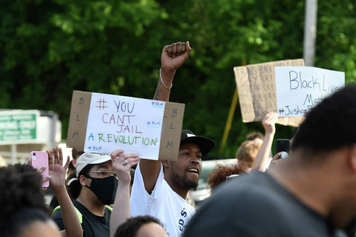 Demonstrators gather outside Schenectady County Jail during a Black Lives Matter rally to end to police brutality and systemic racism on Thursday, June 4, 2020, in Schenectady, N.Y. (Will Waldron/Times Union)