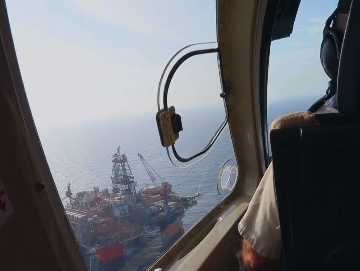 File photo of a helicopter approaching a BP oil platform in the Gulf of Mexico. British oil major BP and Dutch oil major Shell have started coronavirus-safe evacuations for offshore workers in the Gulf of Mexico as Tropical Depression Cristobal grows in strength on a projected path to the Louisiana Coast.