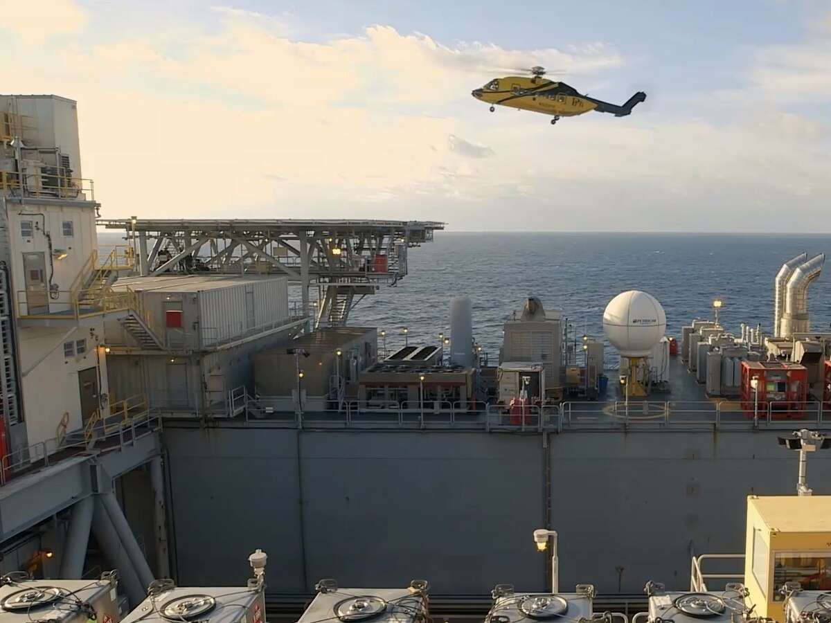 File photo of a helicopter landing at a BP oil platform in the Gulf of Mexico. This year's particularly active hurricane season has wreaked havoc on offshore oil and gas companies, which must temporarily halt production, move rigs and secure platforms and evacuate workers via helicopter whenever a tropical storm approaches.