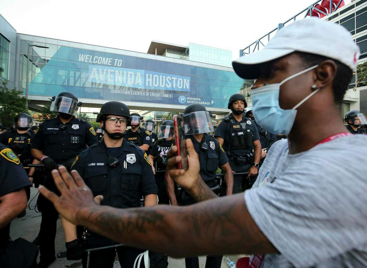 Demonstrators meet police June 2, 2020, in downtown Houston during the fifth night of protests across the nation sparked by the death of former Houston resident George Floyd.