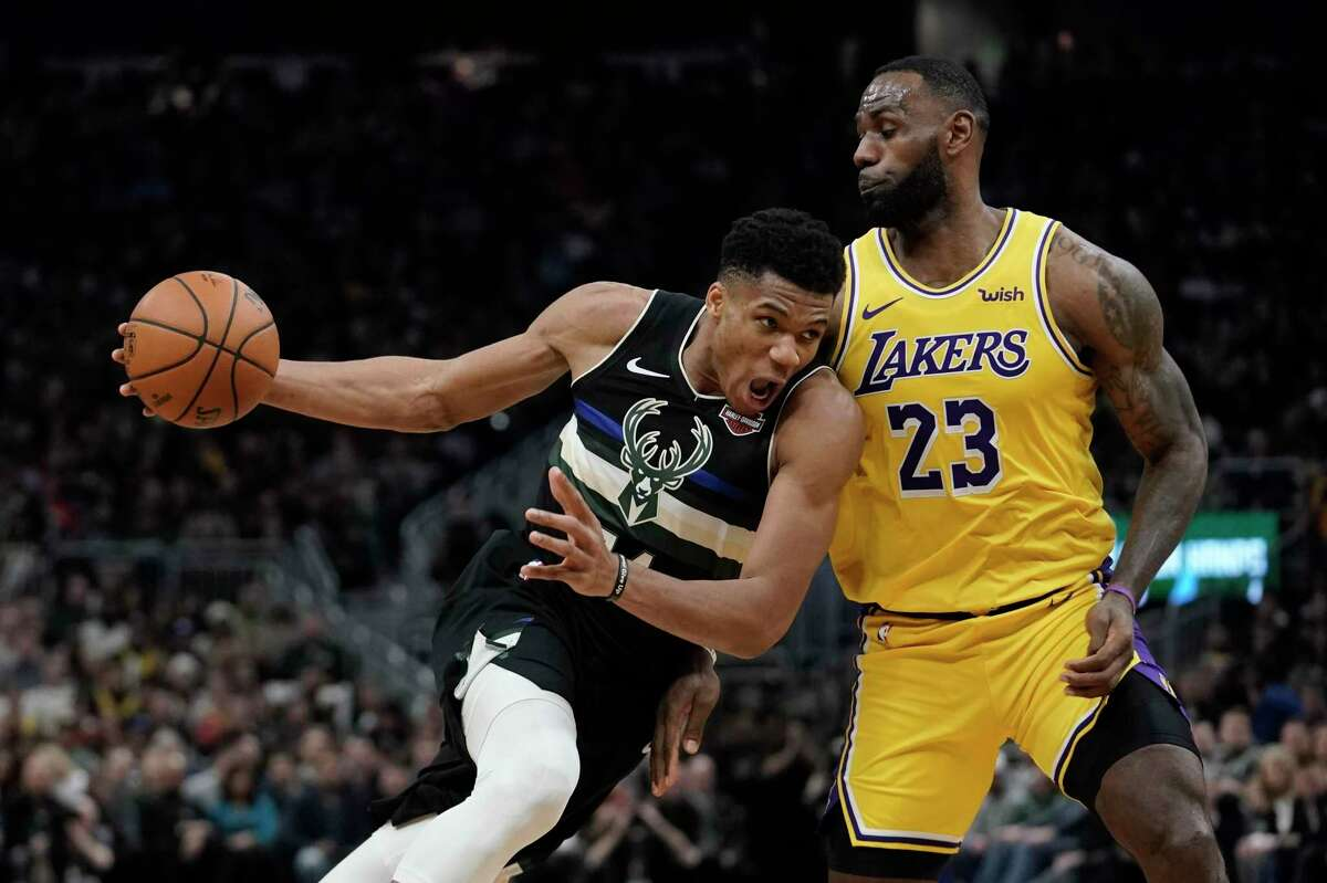 Should they get their presently top-seeded teams to the NBA Finals, the Bucks' Giannis Antetokounmpo, left, and Lakers' LeBron James could be playing as late as Oct. 12.