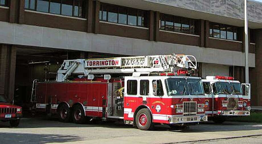 File photo of fire engines at a station in Torrington, Conn. Photo: Contributed Photo / Torrington Fire Department