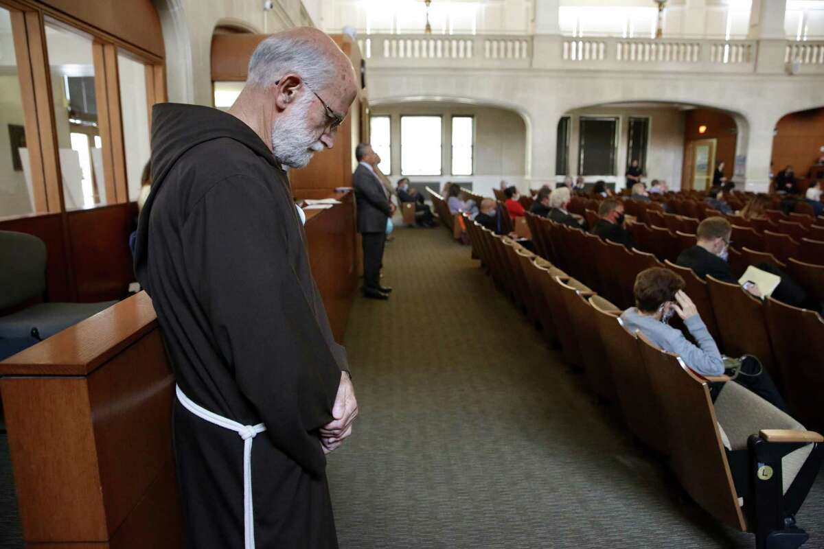 Fr. Bill Kraus prays as San Antonio city council members pause their meeting in silence for 8 min and 46 seconds in honor of George Floyd, on Thursday , June 4, 2020.