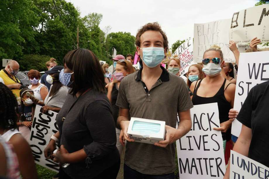 State Sen. Will Haskell, D-Westport, handed out face masks to keep people safe at a protest, during the pandemic in New Canaan on June 4, 2020. On Wednesday night, Haskell criticized Lululemon an Tiffany & Co. for boarding up their stores in Westport. Photo: Grace Duffield / Hearst Connecticut Media