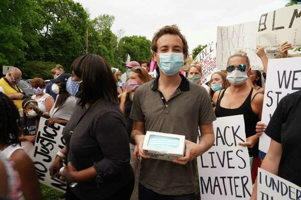 State Sen. Will Haskell, D-Westport, handed out face masks to keep people safe at a protest, during the pandemic in New Canaan on June 4, 2020. On Wednesday night, Haskell criticized Lululemon an Tiffany & Co. for boarding up their stores in Westport.