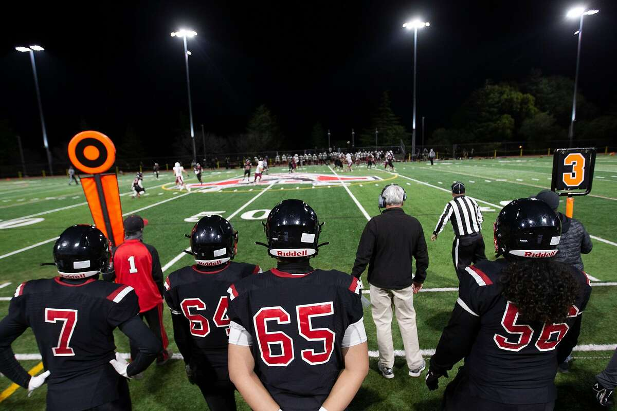 View of high school game from sidelines