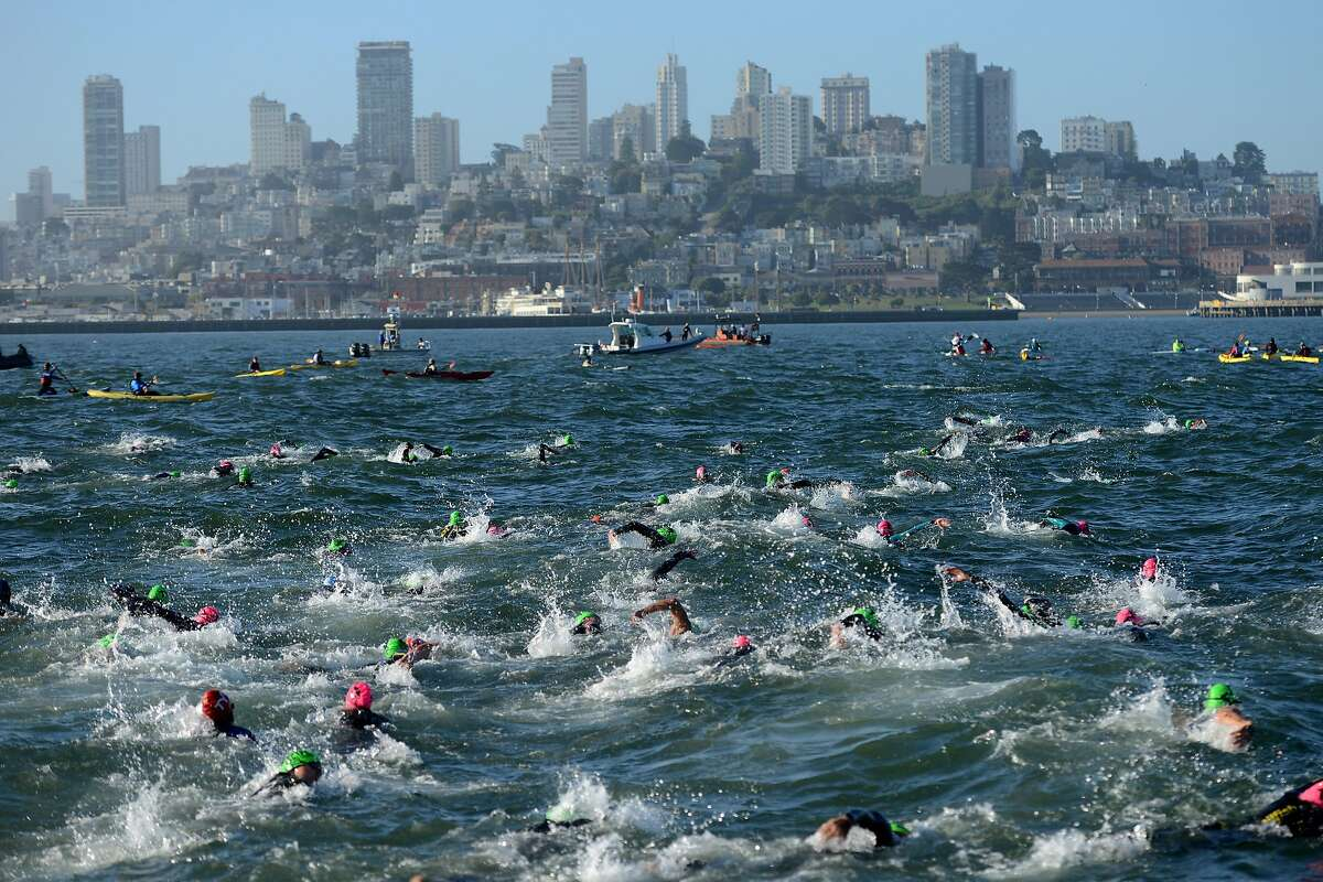 Swimmers fill the Bay to start the triathlon