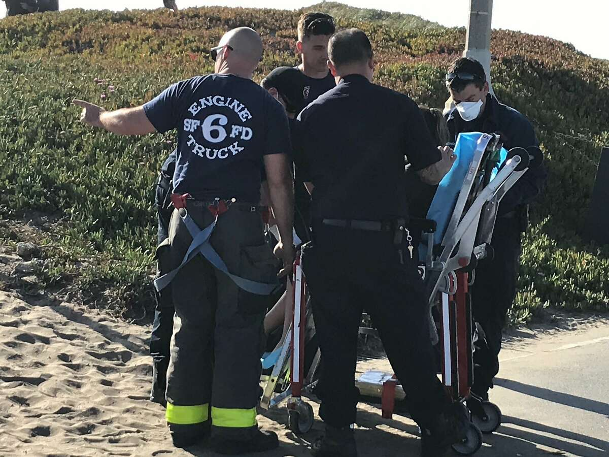 Rescuers pulled two swimmers out the the Ocean Beach surf on Thursday, June 4, 2020.