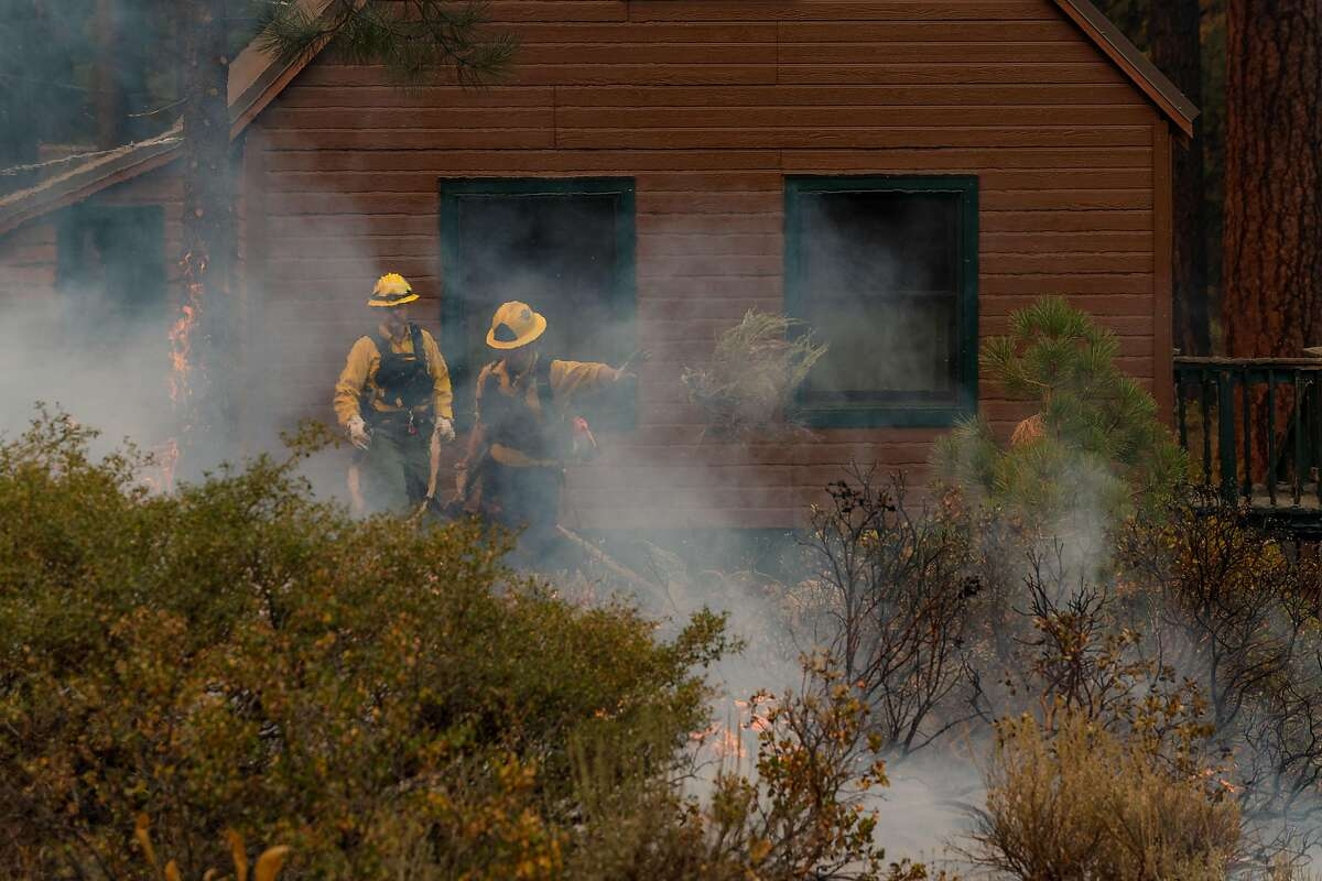 photo of a house shrouded in smoke