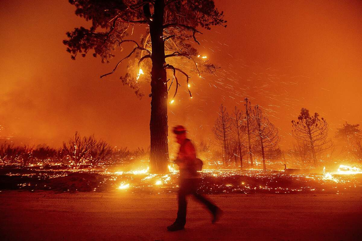 Photo of embers blowing in the wind.