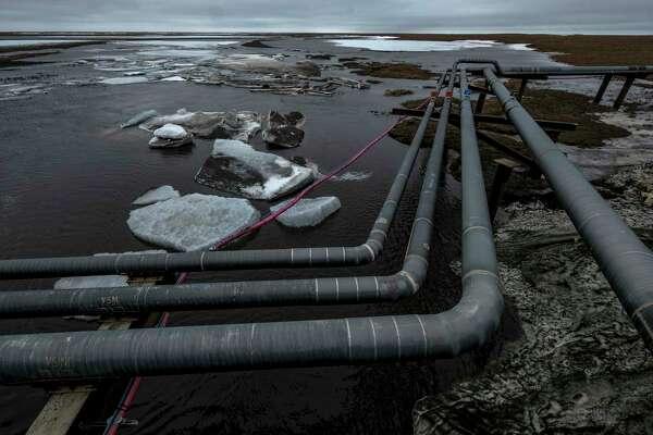 Pipelines extend across the landscape outside Nuiqsut, Alaska, in 2019.