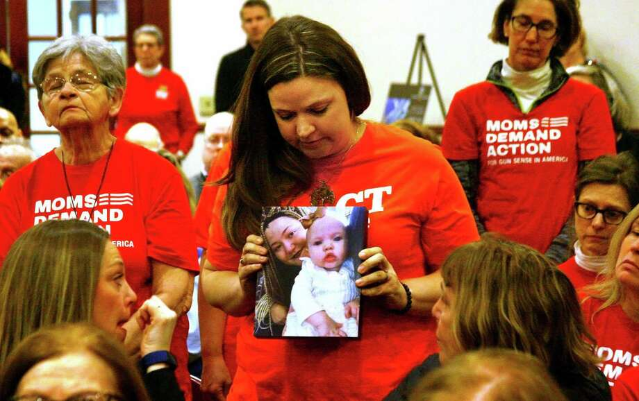 File photo of Erin Bond of Bethel holding a photo of her neice Emily Todd, who was murdered in 2018, during a special state-wide event hosted by Moms Demand Action for Gun Sense in America at the Margaret Morton Government Center in downtown Bridgeport, Conn., on Saturday, Feb. 8, 2020. Photo: Christian Abraham / Hearst Connecticut Media / Connecticut Post