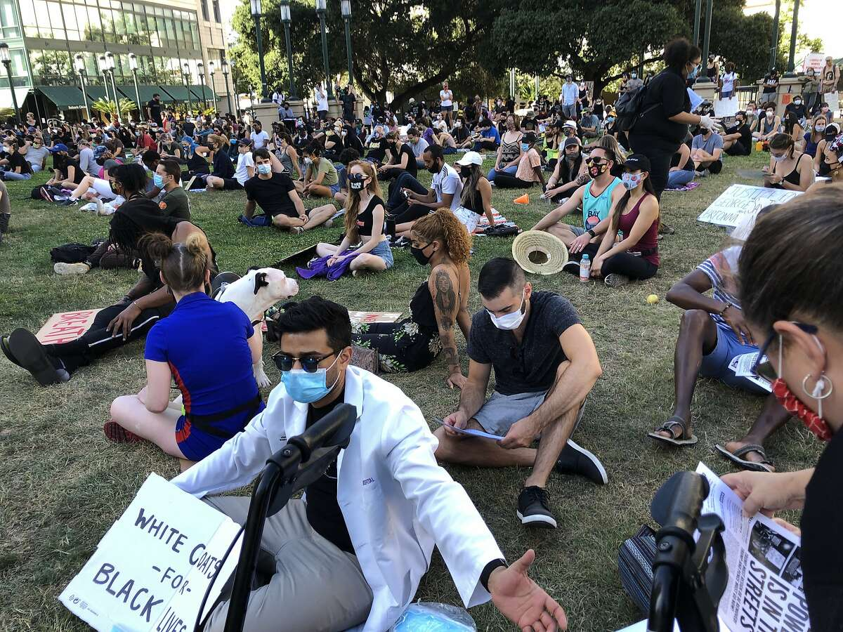 People protesting the killing of George Floyd stage a sit-in at Frank Ogawa Plaza on Monday, June 4, 2020, Oaklamd, Calif.