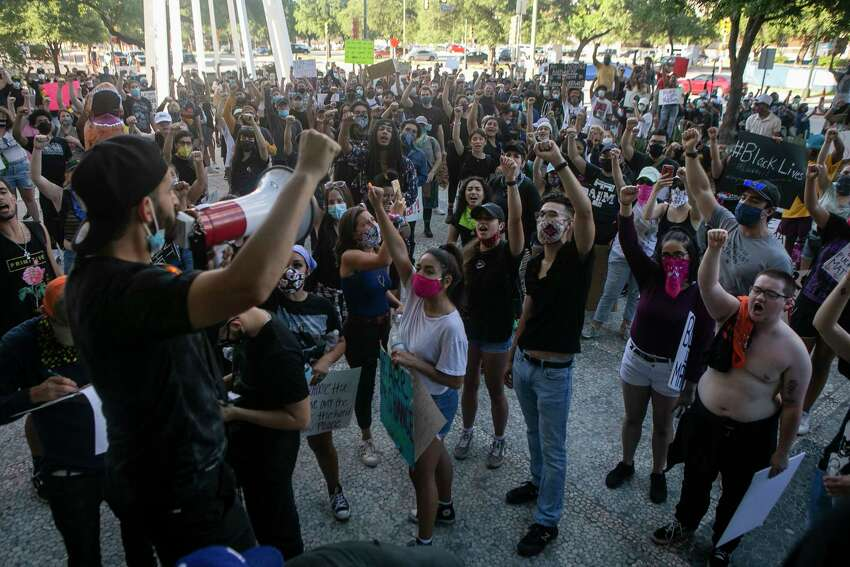 Protestors are lead in a chant outside Public Safety Headquarters in downtown San Antonio, Texas, on June 4, 2020. This is the sixth day of protests in San Antonio in spurred by the killing of a black man, George Floyd, in Minneapolis, on May 25, by officers following a report of Floyd using a counterfeit bill to make a purchase.