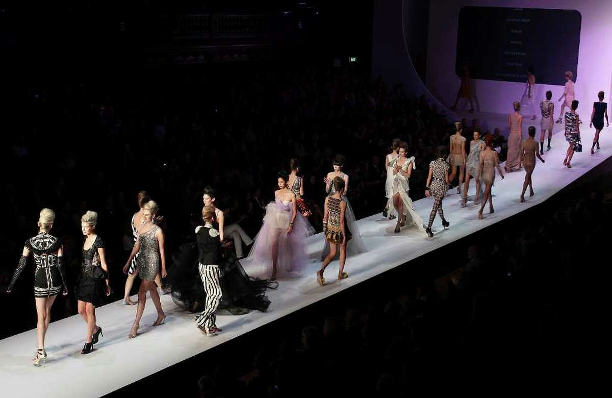 Models walk the runway following the