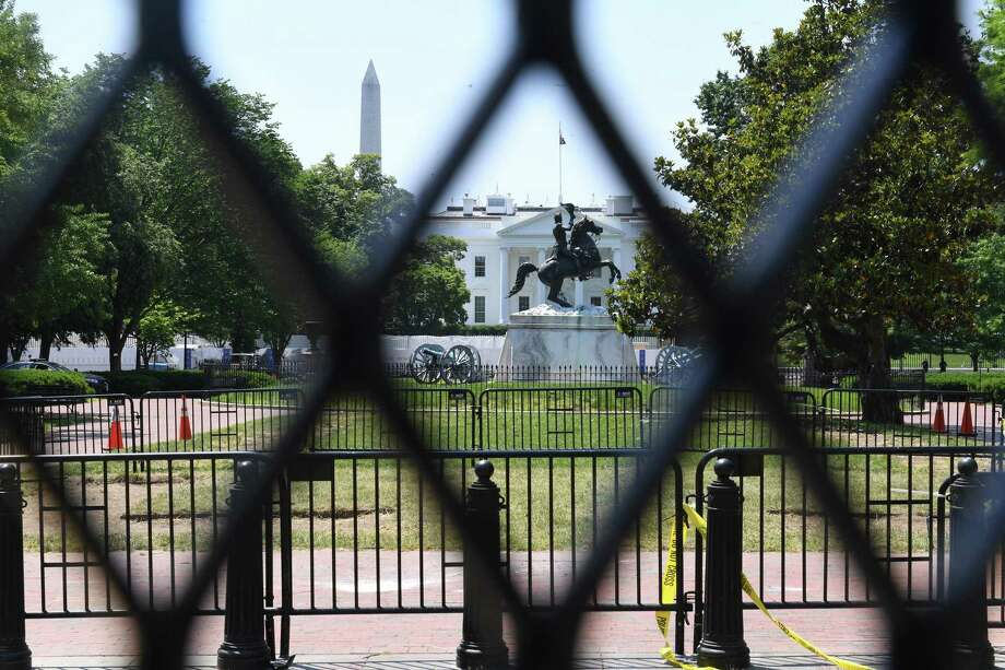 Administration officials stressed that President Trump was not involved in the decision to increase the fencing around the White House, where layers of barricades can be seen along H Street. Photo: Washington Post Photo By Matt McClain / The Washington Post