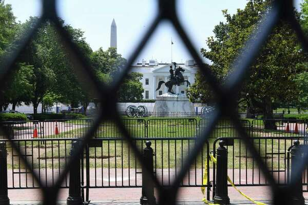 Administration officials stressed that President Trump was not involved in the decision to increase the fencing around the White House, where layers of barricades can be seen along H Street.
