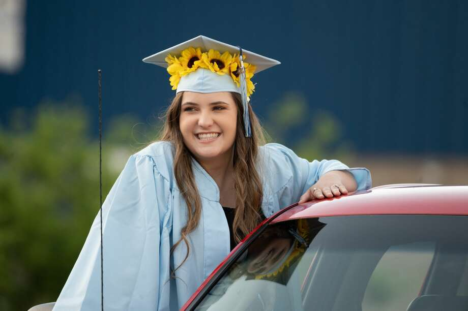 The Meridian Early College High School Class of 2020 celebrate their graduation during a drive-through diploma ceremony Thursday, June 4, 2020 at the school. (Adam Ferman/for the Daily News) Photo: Adam Ferman, (Adam Ferman/for The Daily News)
