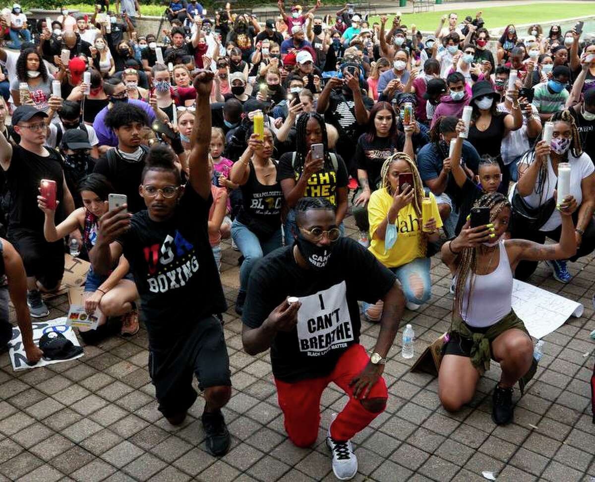 Dozens of people gathered at City Hall to observe an eight-minute moment of silent during a vigil for George Floyd, who died in custody of Minneapolis Police officers last week, on Thursday, June 4, 2020, in Houston.