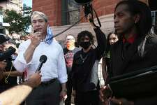 "San Antonio Mayor Ron Nirenberg speaks to protesters Thursday, addressing police brutality and telling them to ""hold me accountable for it because I'm the mayor of this mayor of this goddamn city and we're going to make change together."" On the right is Pharaoh Clark, who later met with the mayor to address their concerns."