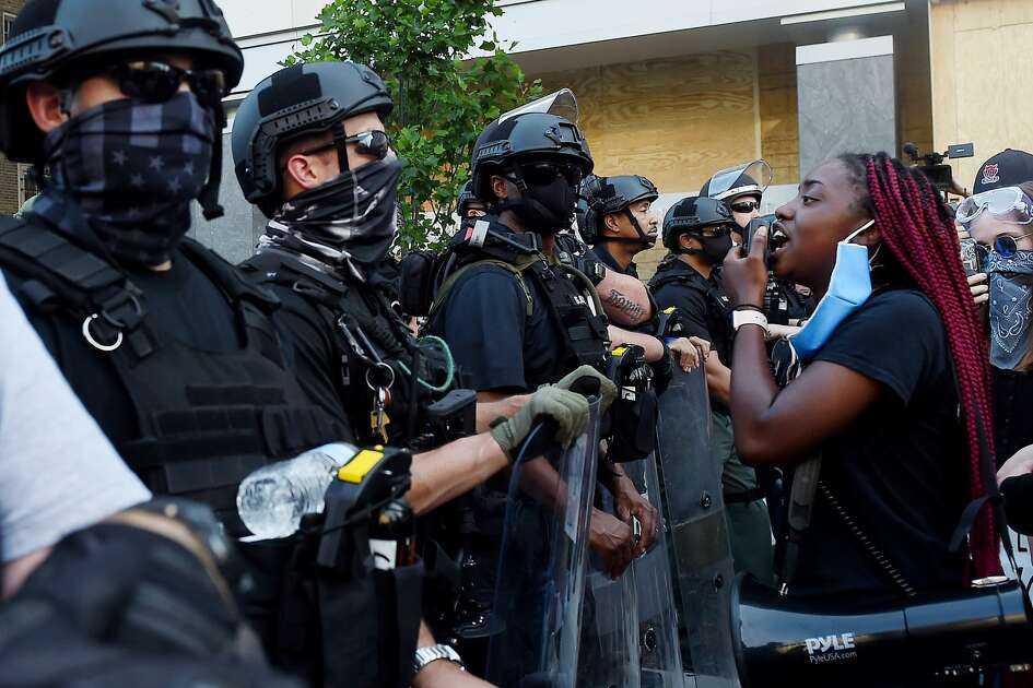 Demonstrators and police face off near the White House during a protest over the death of George Floyd, in Washington, DC, on June 3, 2020. - Former Minneapolis police officer Derek Chauvin, who kneeled on the neck of George Floyd who later died, will now be charged with second-degree murder, and his three colleagues will face charges of aiding and abetting second-degree murder, court documents revealed on June 3.