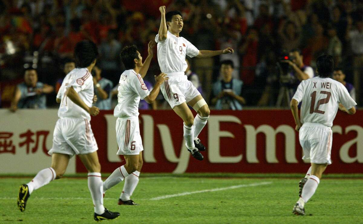 BEIJING, CHINA: China's Hao Haidong (2-R) celebrates his goal with teamates after opening the scoring against Iraq in their quarter-final game in the 2004 Asian Cup Soccer tournament at the Workers Stadium in Beijing, 30 July 2004.