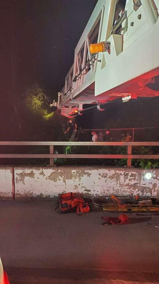 Danbury firefighters rescue an injured man who fell off a bridge trestle on June 4, 2020. Photo: Danbury Fire Department