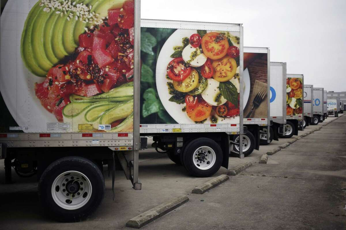 Sysco Corp. delivery trucks sit parked outside the company's distribution center in Louisville, Ky., on Jan. 29, 2020.