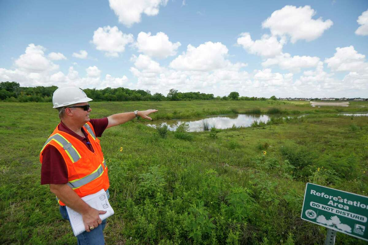 Harris County Flood Control Manager A.Gene Rushing, Jr., looks over a nearly completed section of the Harris County Flood Control Southbelt, Phase 3 and Dagg Road Stormwater Detention Basins project Thursday, June 4, 2020, in Houston.