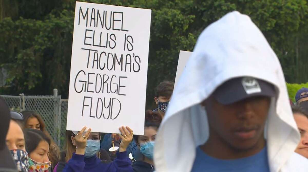 A crowd attends a vigil for Mannie Ellis in Tacoma on June 3, 2020.