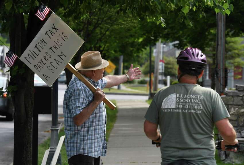 Jim Staulters, left, speaks to a passerby while protesting outside Milton Town Hall on Friday, June 5, 2020, in Milton, N.Y. Staulters is skeptical about the recent condemning of the town building by a town inspector. (Will Waldron/Times Union)