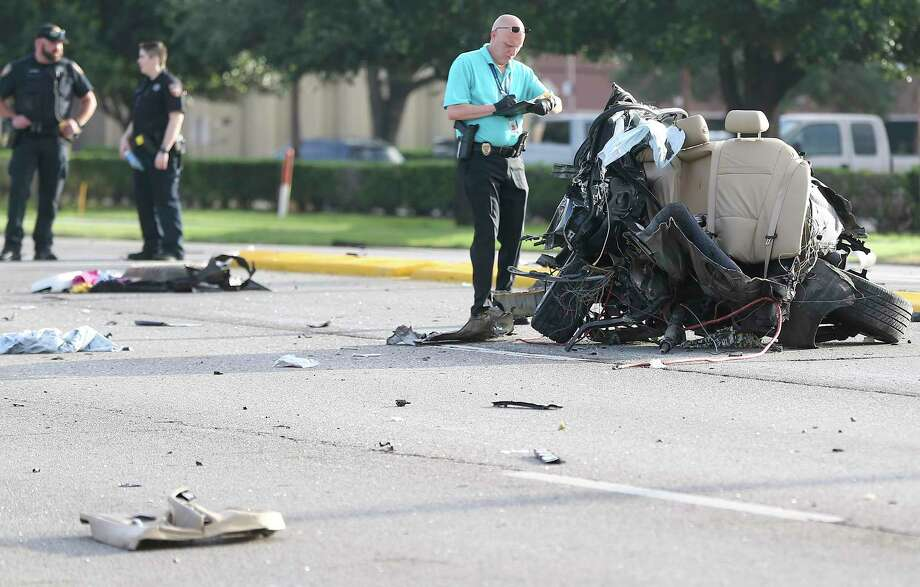 Harris County Sheriff's Department takes a look at the back half of a BMW that split during a fatal accident on Highway 6 in Houston on Friday, June 5, 2020. Photo: Elizabeth Conley, Staff Photographer / © 2020 Houston Chronicle