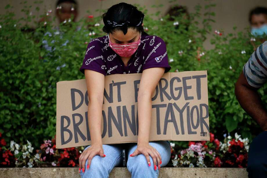 A protester remembering Breonna Taylor listens to a Black Lives Matters rally at City Hall in Dallas on Wednesday, June 3, 2020. Taylor was fatally shot by police officers in Louisville, Ky. (Tom Fox/The Dallas Morning News via AP) Photo: Tom Fox, Associated Press / The Dallas Morning News