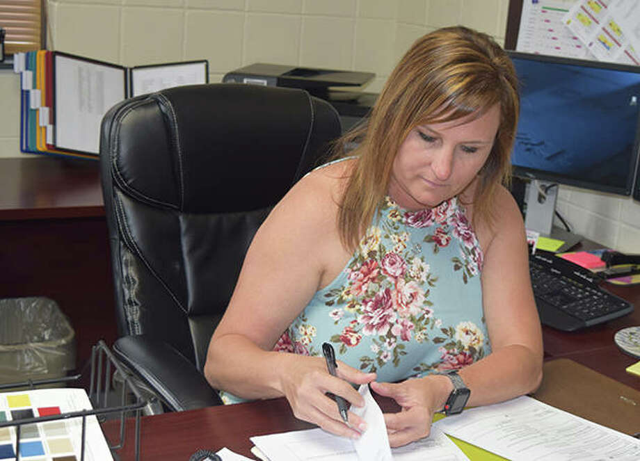 Jacksonville High School Principal Andrea Lee works in her office Thursday. Lee has accepted a position as superintendent for the Calhoun County School District. Photo: Marco Cartolano | Journal-Courier