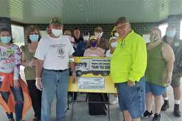 Pictured are volunteers from Chippewa Lake Community Church, Chippewa Lake-Mecosta Lions Club, and Mecosta County Undersheriff James Taylor. Feed America West Michigan and Chippewa Lake Community Church Mobile Produce Program thanked Chippewa Lake-Mecosta Lions Club for sponsoring the first truck of five for 2020. Masks were worn and procedures followed in compliance of COVID-19 rules. (Courtesy photo)