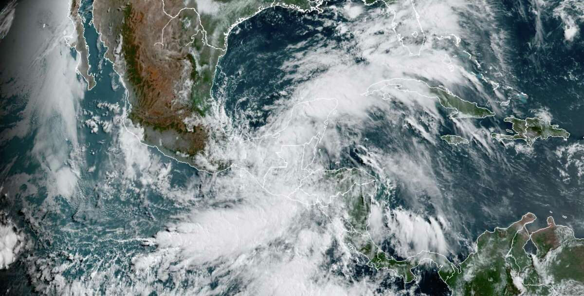 Satellite imagery shows swirling clouds approaching the Gulf of Mexico on Thursday, June 4, 2020. MUST CREDIT: NOAA