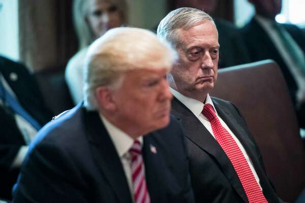President Donald Trump and then-Defense Secretary Jim Mattis listen during a Cabinet meeting at the White House in June 2017.