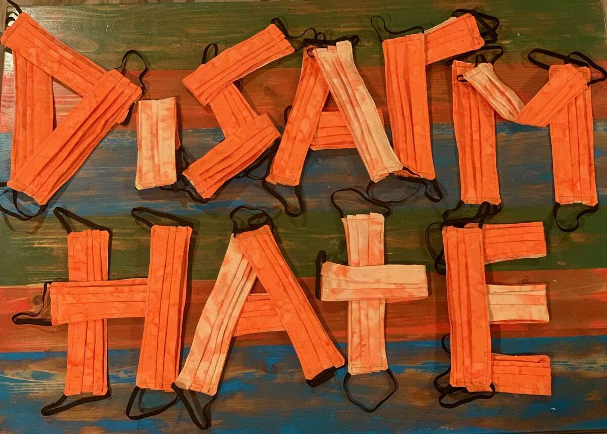 A message made from orange face masks.