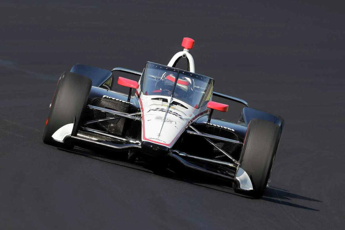 Will Power, of Australia, drives into turn one during Aeroscreen testing at Indianapolis Motor Speedway in October. The 2020 IndyCar season will open Saturday at Texas Motor Speedway. The race will also mark the official race debut of the safety innovation for enhanced driver cockpit protection. The safety feature is a ballistic, canopy-like windscreen anchored by titanium framework encompassing the cockpit.