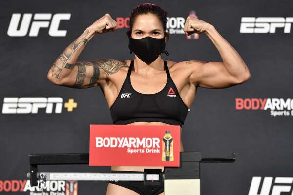 LAS VEGAS, NEVADA - JUNE 05: Amanda Nunes of Brazil poses on the scale during the UFC 250 weigh-in at UFC APEX on June 05, 2020 in Las Vegas, Nevada.