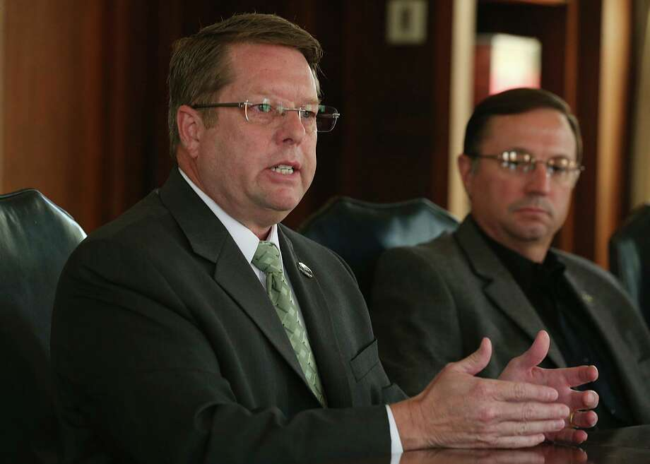 San Antonio Police Officers Association President Mike Helle and others talk with the San Antonio Express-News Editorial Board about ongoing contract negotiations with the City of San Antonio in 2015. On the right is SAPOA Vice President Dean Fischer. Photo: JERRY LARA /San Antonio Express-News / © 2015 San Antonio Express-News