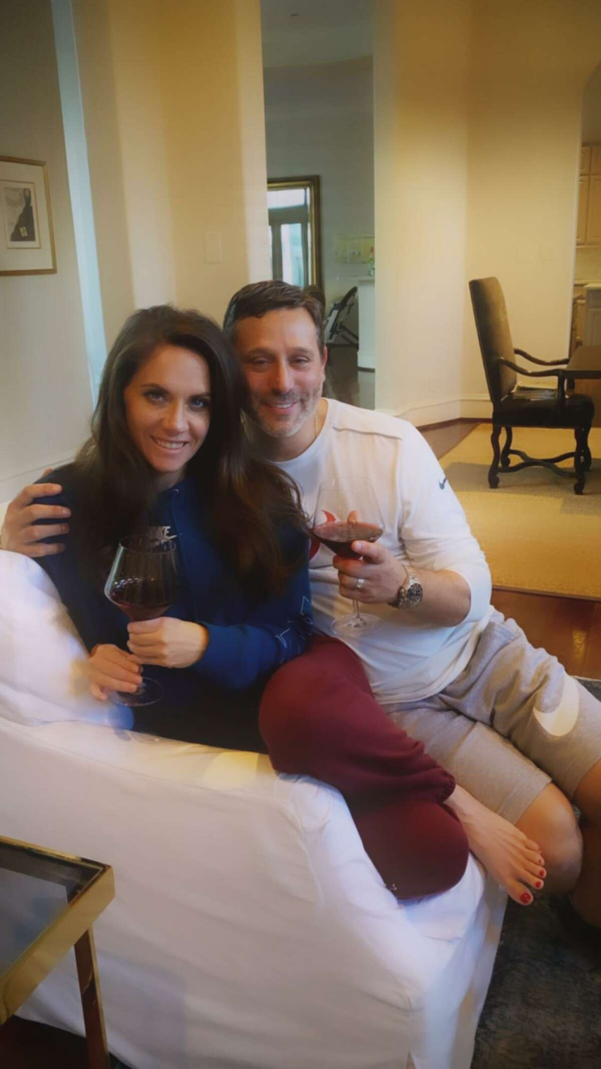 Virtual Wine Dinner chairs Joanna and Brad Marks raise a glass at home.