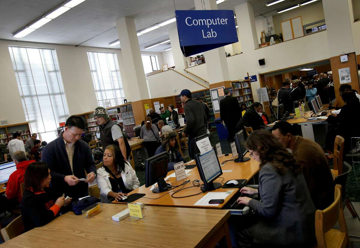 The computer lab area of Oakland's public library on 14th Street, during an application event for the Oakland Housing Authority. Libraries have been a crucial resource for people who lack home Internet access.